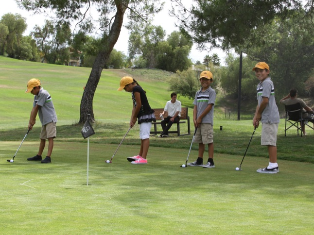 Youngsters learn the game of golf