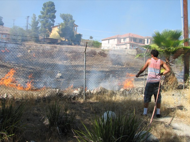 Neighbors pitch in to help with brush fire