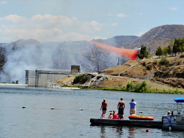 Fireworks started brush fire behind dam Saturday