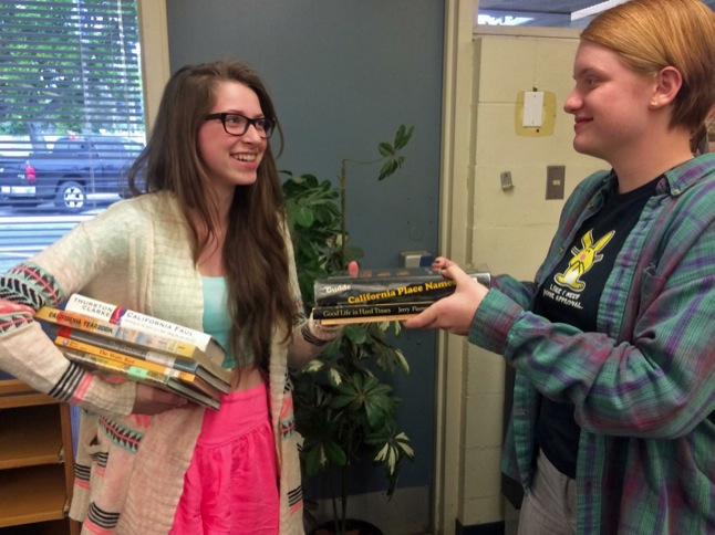 Karina Bowen collecting books for 'Mastermind' pageant