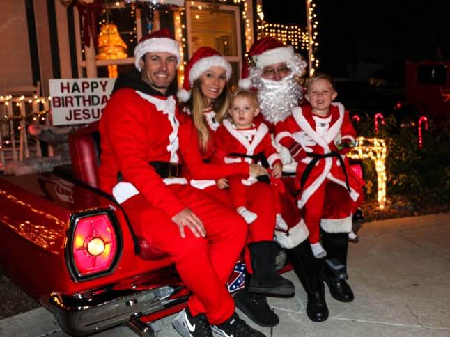 Santa greets residents from 'Hot Rod Throne'