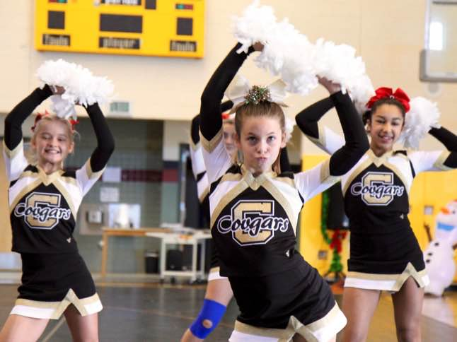 CLMS Cheer provides holiday cheer  during school assemblies