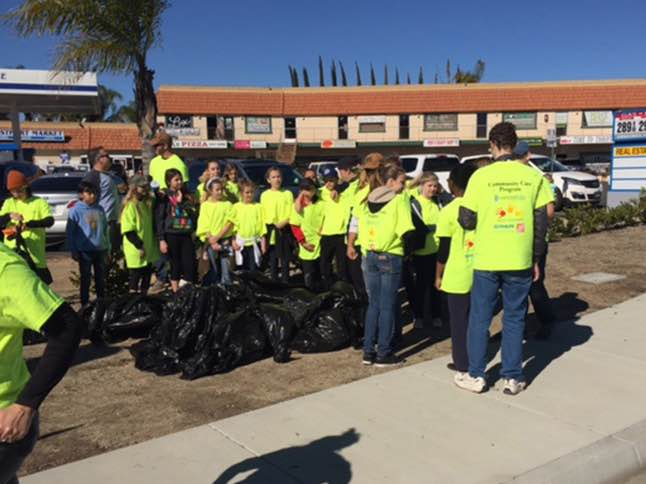 Community Care Program volunteers clean up community